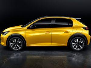 Peugeot 208 2020 amarillo lateral fondo negro