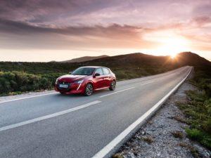 Peugeot 208 2020 rojo carretra infinita amanecer